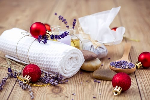 Holiday spa treatment with lavender, rocks, and a towel