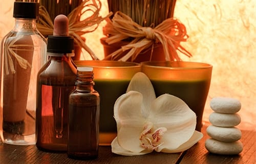 Essential oil, aromatherapy candles and flowers