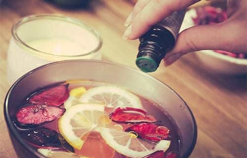 pouring essential oil into a bowl